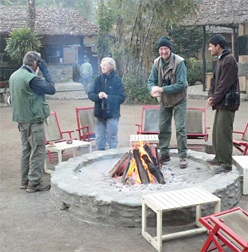 A warming fire at Machan (Chitwan)